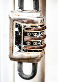 Old Rusted Combination Lock Hanging from a Fence Stock Image