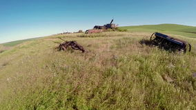 Old rusted Combine abandoned in a farmers fields stock footage