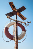 Old rusted cross shaped navigation sign Stock Photos