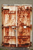 Old rusted doors padlocked close. Old rusted doors chained and padlocked shut Royalty Free Stock Photography