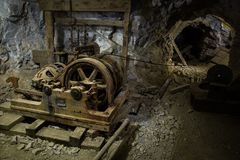Old rusted equipments inside a mine Royalty Free Stock Photo