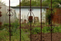 Old rusted fence overgrown Stock Photos