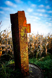 Old rusted fence post Stock Photo