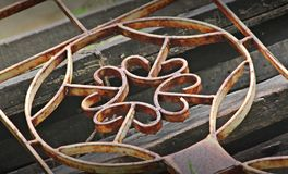 Old rusted fence. Old rusty iron on a pile of wood Stock Images