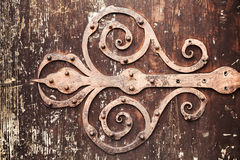 Old rusted forged decorative door hinge Royalty Free Stock Images
