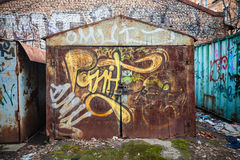 Old rusted garages with grungy graffiti pattern. Saint-Petersburg, Russia - April 3, 2015: Old rusted garages with grungy graffiti pattern. Vasilievsky island stock images