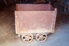 Old Rusted Gold Ore Cart. Old disused and abandoned gold mine trolley used to cart ore during the gold rush days in Australia stock photography