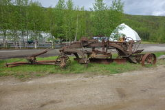 An old, rusted grader. Stock Photo