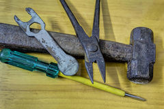 Old rusted hammer, pliers, spanner, driver Royalty Free Stock Photography
