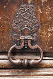 Old rusted knocker on wooden door in Paris Stock Photos