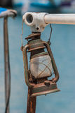 Old rusted lamp on a fishing boat. Royalty Free Stock Images