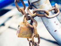 Old rusted lock and chain. Royalty Free Stock Photo
