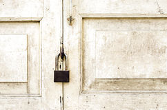 Old rusted lock on old white door Royalty Free Stock Images