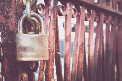 Old rusted lock on the red rusted door Royalty Free Stock Image