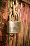 Old rusted lock on the red rusted sliding door Royalty Free Stock Photos