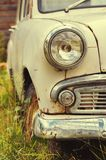 The old rusted machine. Front view where there is a spotlight with a grille and a bumper Royalty Free Stock Photo