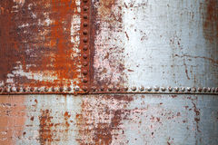Old rusted metal background texture. With rivets Royalty Free Stock Photos