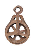 Old rusted metal pulley isolated. Royalty Free Stock Photos
