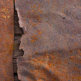 Old rusted metal surface texture. With wood royalty free stock images