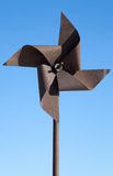 Old rusted metal wind whirligig Royalty Free Stock Image