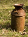Old Rusted Milk Can. Old Rusted Milkcan sitting in field Stock Photos