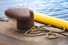 Old rusted mooring bollard Stock Photo