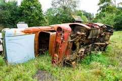 Old rusted out scrap car Zhiguli in forest stock images