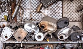 Old and Rusted Pile of Car Exhaust Muffler in a Exhaust Shop.  Royalty Free Stock Photo