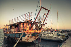 Old rusted pleasure boat is moored in Nesebar Royalty Free Stock Photo