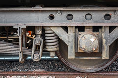Old rusted railway carriage wheel with suspension Royalty Free Stock Image