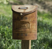 Old, rusted rural mail box still in use Stock Image