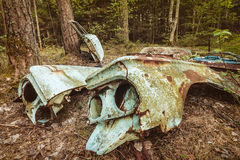 Old rusted scrap car in a forest Royalty Free Stock Image