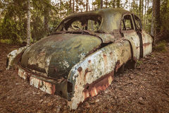Old rusted scrap car in a forest Royalty Free Stock Photography