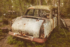 Old rusted scrap car in a forest Stock Photography