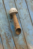 Old rusted sound horn. On a blue weathered wooden background royalty free stock image