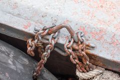 Old rusted steel chains were fastened to the hoop. To hold the object royalty free stock images