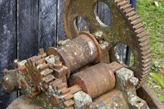 Old rusted sugar cane mill. Old rusty sugar cane mill, used as a decorative element in a farm restaurant in Brazil stock image
