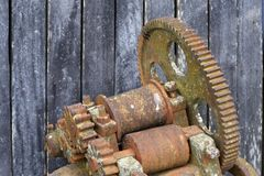Old rusted sugar cane mill. Old rusty sugar cane mill, used as a decorative element in a farm restaurant in Brazil stock images