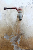 Old rusted tap on wall Stock Images