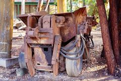 Old Rusted Tipper Once Used To Cart Ore. Rusted iron gold mining equipment now used as part of a tourist attraction at an abandoned gold mine. Old tipper once royalty free stock photography