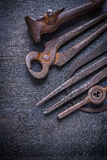 Old rusted tools on  vintage board Royalty Free Stock Photos