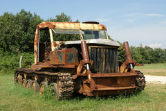 Old rusted tractor in a summer field Stock Image