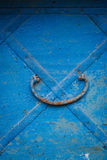 Old rusted trunk handle. Old rusted metal pen on a blue trunk stock photo