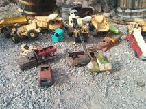 Old, rusted vintage toy vehicles on the ground royalty free stock images