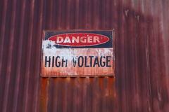 Old voltage warning sign Royalty Free Stock Photo
