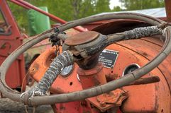 Old rusted and weathered tractor steering wheele. Closeup photo Royalty Free Stock Image