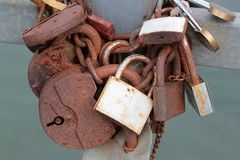 The old rusted wedding locks on the bridge closeup Stock Image