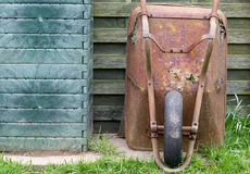 Old rusted wheelbarrow Stock Photos