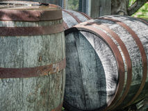 Old rusted wine barrels outside Royalty Free Stock Photos