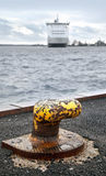 Old rusted yellow mooring bollard Royalty Free Stock Image